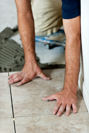 Laying a floor tile